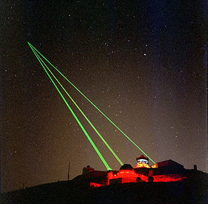 Starfire Optical Range - Three green lasers being fired at a single spot in the sky from the Starfire Optical Range.
