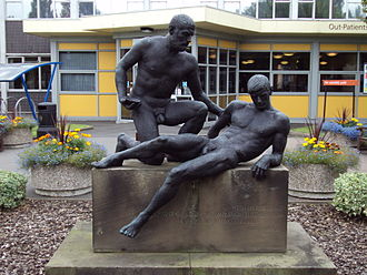 Selly Oak Hospital - The Good Samaritan (1961), by Uli Nimptsch, in front of the Out-patients Unit at Selly Oak Hospital