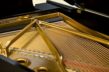 Strings of a grand piano Steinway Grand Piano Iron Plates and Strings.jpg