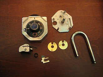 Combination lock - The component parts of a Stoplock combination padlock.