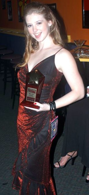 NightMoves Award - Sunny Lane holding her Best New Starlet trophy at the 2005 NightMoves Awards Show
