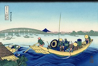 Sunset across the Ryogoku bridge from the bank of the Sumida river at Onmaya-gashi