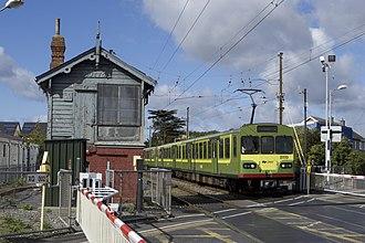Dublin Area Rapid Transit - An 8100 Class DART train (8119) at level crossing near Sutton