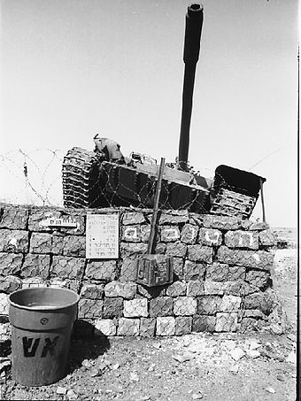 An abandoned Syrian T-55 tank on the Golan Heights Syrian Tank Blocked From Attacking an IDF Post - Flickr - Israel Defense Forces.jpg