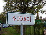 Szolnok city limit sign written in Rovas script (erected in 2010)