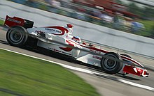 Photo de Takuma Sato sur la SA05 au GP des USA 2006