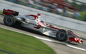 Super Aguri F1 - Takuma Sato driving for Super Aguri at the 2006 United States Grand Prix.