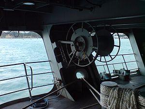 Fairlead - Three mooring hawsers running through fairlead on a RNZN ship.