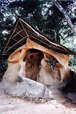 A shrine in the Osun-Osogbo Sacred Grove, in O...