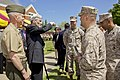 The 35th Commandant of the Marine Corps, Gen. James F. Amos, left, and retired Secretary of the Navy and former Virginia Sen. John Warner, second from left, speak with Marines following the ground breaking 130502-M-LU710-144.jpg
