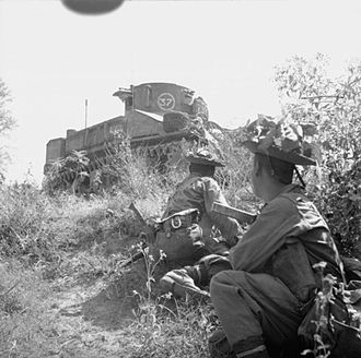 6th Queen Elizabeth's Own Gurkha Rifles - Men of the 6th Gurkha Rifles go into action at Singu on the Irrawaddy bridgehead with Stuart tanks in support, February 1945.