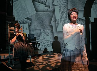 Desegregation - Hate mail written in the late 1950s regarding desegregation of Little Rock Central High School is projected over actresses Mary-Pat Green and Gia McGlone in Arkansas Repertory Theatre's 2007 production of The Legacy Project: It Happened in Little Rock.