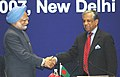 The Prime Minister, Dr. Manmohan Singh taking over the chairmanship of SAARC Summit from the Chief Advisor of Bangladesh, Dr. Fakhruddin Ahmed, during the inauguration of the 14th SAARC Summit, in New Delhi on April 03, 2007.jpg