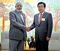 The Prime Minister, Shri Narendra Modi meeting the Mayor of Busan Metropolitan City, Mr. Suh Byung-Soo, at Gimhae Air Base, Busan, South Korea on May 19, 2015.jpg