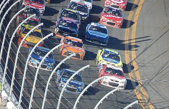 Auto racing - Jimmie Johnson leads the field racing three-wide multiple rows back at Daytona International Speedway in the 2015 Daytona 500.