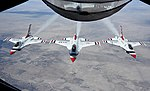 Three F-16 Fighting Falcons fly in formation after receiving fuel from a KC-135 Stratotanker (31919536274).jpg