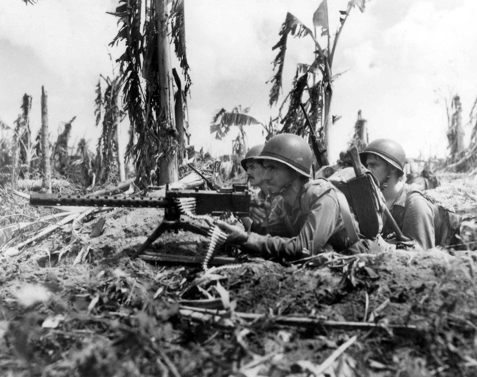 Three Marines and their machine gun on Guam