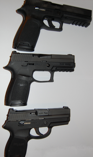 SIG Sauer P250 - Top: P250 Full Size, middle: P250 Compact (with the trigger group removed), bottom: P250 Sub Compact.