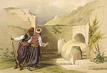 Coloured lithograph showing 2 men at the foot of a barren hill looking towards a large stone with a rounded top between two standing stones and with an arched opening in an ashlar wall in the background