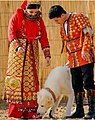 Traditional dressed bride and groom with Alabay dog.jpg