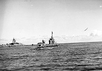 Action of 8 June 1945 - HMS Trenchant flying the Jolly Roger after sinking Ashigara