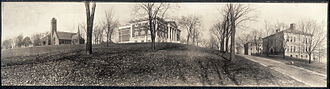Tufts University - Walnut Hill as it appeared prior to the construction of Tisch Library and steps, circa 1910. In the center is Eaton Hall. The road to the right no longer exists.