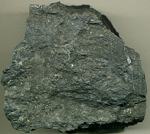 """Carlin–type gold deposit - Carlin-type gold ore from the Twin Creeks mine, Nevada, near the Getchell Mine. This is an auriferous, silicified-decalcified siltstone/mudstone from the Comus Formation (Lower Ordovician). Ore grade is about 0.20 to 0.25 ounces of gold per ton of rock. The gold  mineralization is very finely disseminated: """"invisible gold""""."""