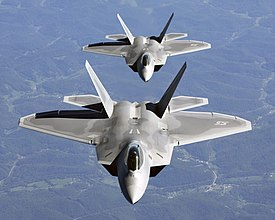 Two F-22A Raptor in column flight - (Noise reduced).jpg