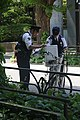 Two police officers and a bicycle at entrance to Meiji Shrine.jpg