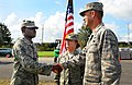 U.S. Air Force Staff Sgt. Kelvin Isaac, left, with the 159th Medical Group, Louisiana National Guard (LANG), is congratulated by Maj. Todd Hubbell, right, the officer in charge of the 214th Engineering 120903-F-PB681-042.jpg