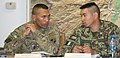 U.S. Army Command Sgt. Maj. Isaia T. Vimoto, left, the command sergeant major of the International Security Assistance Force Joint Command and the 18th Airborne Corps, and Afghan Nation Army Command Sgt. Maj 140327-A-ZA744-030.jpg