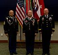 U.S. Army Staff Sgt. Brian Norheim, center, an air and missile defense noncommissioned officer in charge with U.S. Army Central (USARCENT), stands with Command Sgt. Maj. John Harris, left, the senior enlisted 131213-A-XY876-004.jpg