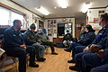 U.S. Coast Guard Cmdr. Joe Sundland, the executive officer of the maritime security cutter USCGC Bertholf (WMSL 750), and members of the crew meet with Wainwright, Alaska, Mayor Enoch Oktollik, search and rescue 120907-G-VS714-134.jpg