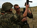 U.S. Marine Corps Lance Cpl. Matthew A. Ivey, right, with Black Sea Rotational Force (BSRF) 11, shows an M16A4 rifle to an Azerbaijan Land Forces (ALF) soldier for familiarization during a training exercise 110804-M-OB762-006.jpg