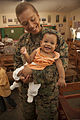 U.S. Marine Corps Maj. Grace Janosek, the officer in charge of the Joint Civil Military Operations Task Force civil affairs element, holds a baby during a medical civic action program at the Amungan Elementary 130407-M-UY788-043.jpg