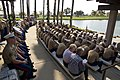 U.S. Marines, Airmen and attendees bow their heads in prayer during the memorial service for Laura Froehlich at the Riverside National Cemetery in Riverside, Calif., Aug. 10, 2012 120810-F-YU985-123.jpg