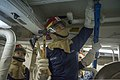 U.S. Navy Gas Turbine System Technician (Electrical) Fireman Jared Camacho installs shoring during a drill aboard the guided missile destroyer USS Mustin (DDG 89) in Yokosuka, Japan, Jan. 17, 2014 140117-N-TU910-198.jpg