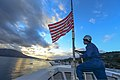 U.S. Navy Seaman Jetaime Mays raises the Navy Jack aboard the guided missile cruiser USS Monterey (CG 61) following the ship's arrival at Naval Support Activity Souda Bay, Greece, Dec. 8, 2013, for 131208-N-QL471-068.jpg