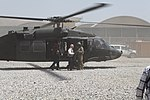 U.S. Sen. Bob Corker of Tennessee, in white shirt, arrives at Camp Integrity, Afghanistan, July 7, 2013, aboard a U.S. Army UH-60 Black Hawk helicopter 130707-N-QV903-001.jpg