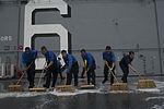 USS America deck scrubbing 140911-N-MZ309-060.jpg