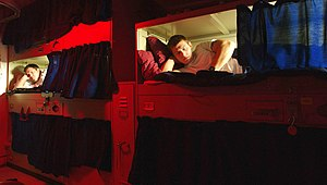 Berth (sleeping) - Sailors in their bunks aboard USS John C. Stennis (CVN-74).