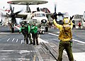 US Navy 030122-N-9593M-005 An Aviation Boatswain's Mate directs an E-2C Hawkeye assigned to Carrier Airborne Early Warning Squadron One One Three (VAW-113) in preparation to launch from aboard USS Abraham Lincoln (CVN 72).jpg