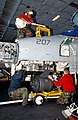 US Navy 030312-N-4965F-503 Aviation Ordnancemen load an M61A1 gattling gun onto an F-A-18C Hornet.jpg