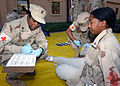 US Navy 040303-N-8955M-003 Emergency medical personnel assess a victim's wounds from a simulated bomb explosion during Exercise Desert Sailor 2004 at Naval Support Activity Bahrain.jpg