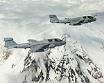 US Navy 040519-N-6436W-006 Two EA-6B Prowlers assigned to the Cougars of Electronic Attack Squadron One Three Nine (VAQ-139) fly in formation around Washington's Mount Rainier.jpg
