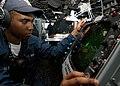US Navy 040615-N-1512S-032 Operations Specialist Seaman Ogechi Ohale, from Arlington, Texas, monitors a radar scan.jpg