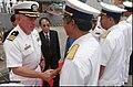 US Navy 040728-N-8796S-117 Commanding Officer, USS Curtis Wilbur (DDG 54), Cdr. John T. Lauer III, greets members of the Vietnamese Navy upon arrival in the city of Da Nang, Vietnam.jpg