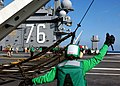 US Navy 041108-N-7130B-096 Air Department personnel raise the emergency-landing barricade during a test of the equipment aboard the USS Ronald Reagan (CVN 76).jpg