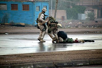 1st Battalion, 8th Marines - Two Marines attempting to recover a fellow wounded 1/8 Marine. During Operation Phantom Fury, November 2004.