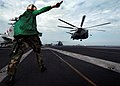 US Navy 041206-N-4308O-060 Aviation Electrician's Mate 3rd Class Megan Truncer signals an MH-53E Sea Dragon.jpg